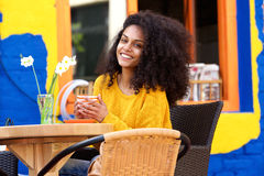 Beautiful woman having coffee at cafe Stock Image