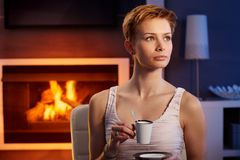 Beautiful woman having coffee in cosy room Royalty Free Stock Photography