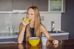 Beautiful woman having coffee and fruits for breakfast royalty free stock photos