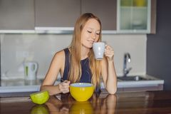 Beautiful woman having coffee and fruits for breakfast stock photo
