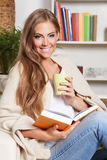 Beautiful woman having a cup of drink Royalty Free Stock Photography
