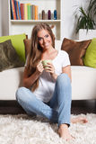 Beautiful woman having a cup of drink Stock Image