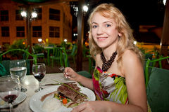Beautiful woman having dinner Royalty Free Stock Image