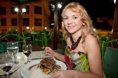 Beautiful woman having dinner Royalty Free Stock Image