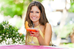 Beautiful woman having a drink Royalty Free Stock Images