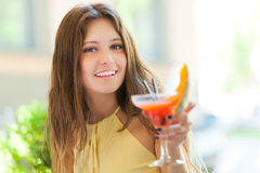 Beautiful woman having a drink Royalty Free Stock Photography