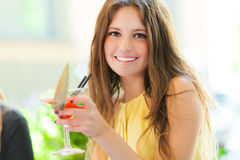 Beautiful woman having a drink Stock Photos