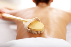 Beautiful woman having exfoliation treatment in spa Royalty Free Stock Photography