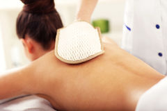 Beautiful woman having exfoliation treatment in spa. Picture of beautiful women getting exfoliation treatment in spa Royalty Free Stock Photos
