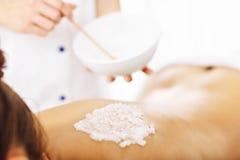 Beautiful woman having exfoliation treatment in spa. Picture of beautiful women getting exfoliation treatment in spa Stock Photo
