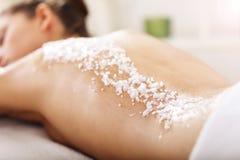 Beautiful woman having exfoliation treatment in spa. Picture of beautiful women getting exfoliation treatment in spa Royalty Free Stock Images