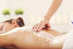 Beautiful woman having exfoliation treatment in spa. Picture of beautiful women getting exfoliation treatment in spa Stock Image