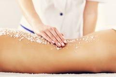 Beautiful woman having exfoliation treatment in spa. Picture of beautiful women getting exfoliation treatment in spa Royalty Free Stock Image