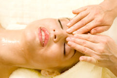 beautiful woman having facial massage. Stock Images