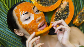 Beautiful woman having fresh papaya facial mask apply. fresh pap Stock Image