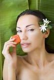 Beautiful woman having fresh papaya facial mask apply. fresh pap Stock Photo