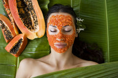 Beautiful woman having fresh papaya facial mask apply. fresh pap Stock Images
