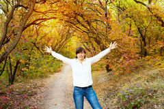 Beautiful woman having fun in the magical autumn forest. Stock Photography