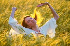Beautiful woman having fun in the wheat field Stock Photo
