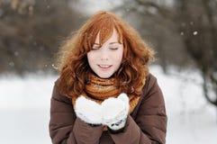 Beautiful woman having fun in winter Stock Images