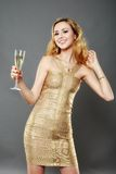 Beautiful woman having a glass of champagne Stock Image