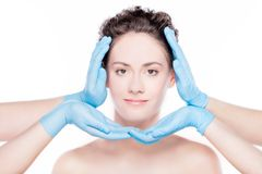 Beautiful woman having her face improved by plastic surgeons. Royalty Free Stock Photography