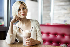 Beautiful Woman Having Hot Chocolate With Cream In Cafe Royalty Free Stock Photo