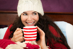 Beautiful woman having hot drink Stock Photos