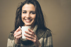 Beautiful woman having an hot drink Royalty Free Stock Images