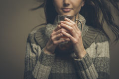 Beautiful woman having an hot drink Stock Photos