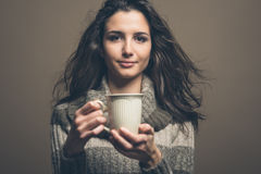 Beautiful woman having an hot drink Stock Image