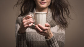 Beautiful woman having an hot drink Royalty Free Stock Photography