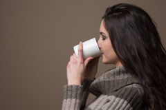 Beautiful woman having an hot drink Royalty Free Stock Photo