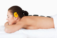 Beautiful woman having a hot stone massage Royalty Free Stock Image