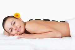 Beautiful woman having a hot stone massage Royalty Free Stock Image