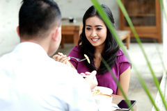 Beautiful woman having lunch together with her boyfriend Stock Images