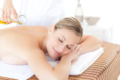 Beautiful woman having a massage with massage oil Royalty Free Stock Photos