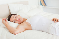 Beautiful woman having a nap Royalty Free Stock Image