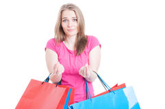 Beautiful woman having no money after a day of shopping Royalty Free Stock Photo