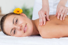 Beautiful woman having a shoulder massage Royalty Free Stock Image