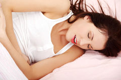 Beautiful woman having a stomach ache. Royalty Free Stock Photo