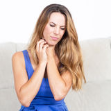 Beautiful woman having throat problems. Woman in blue dress needs medication royalty free stock photography