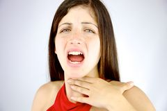 Beautiful woman having voice problem. Sad woman feeling sick without voice royalty free stock photography