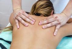 Beautiful woman having a wellness back massage Royalty Free Stock Photos