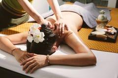 Beautiful woman having a wellness back massage. Stock Photography