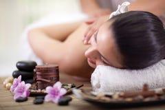 Beautiful woman having a wellness back massage at spa salon. Beautiful woman having a wellness back massage royalty free stock photos