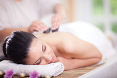 Beautiful woman having a wellness back massage at spa salon Royalty Free Stock Images