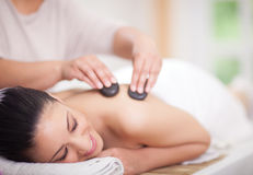 Beautiful woman having a wellness back massage at spa salon with Stock Photos