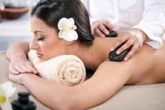 Beautiful woman having a wellness back massage at spa salon Stock Images