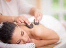 Beautiful woman having a wellness back massage Royalty Free Stock Image